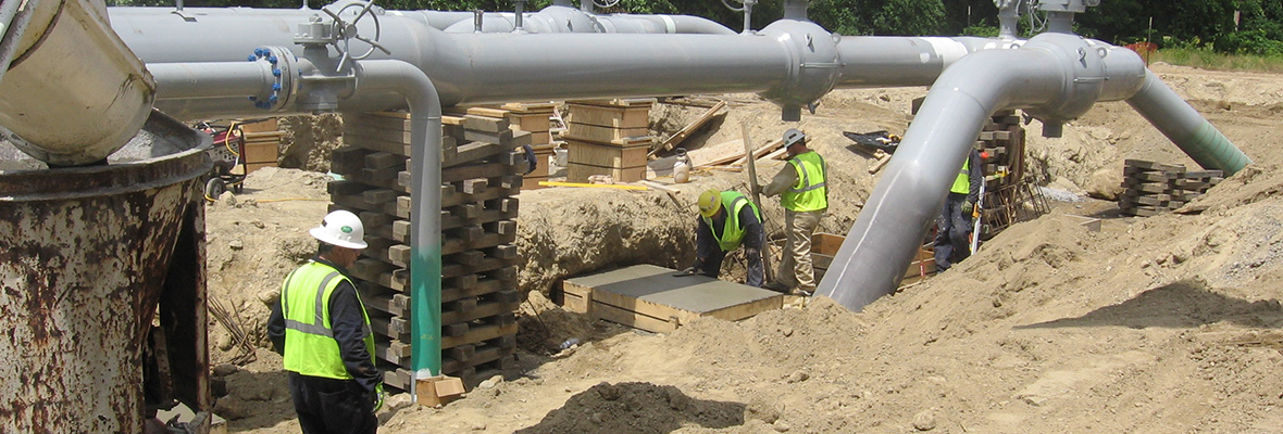 Pouring concrete footings at an industrial location