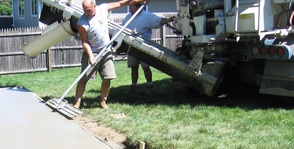 Pouring and smoothing concrete for an outdoor residential patio