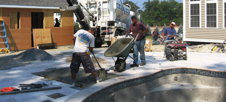 Pouring concrete for a residential pool deck